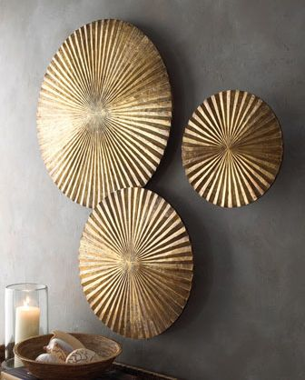 Arteriors Apollo Wall Medallions: Wall medallions offer texture and interest as well as a nice departure from the expected. Each is handmade of mango wood with a golden finish and has a bracket on back for hanging.    Small medallion, size varies from 12