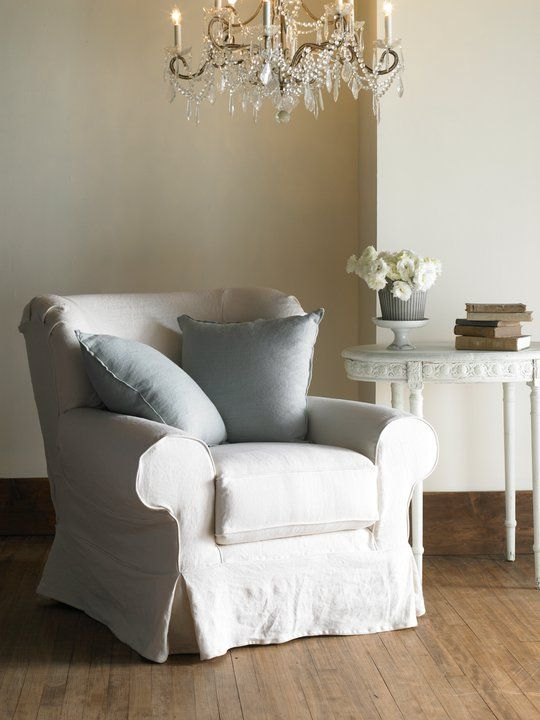 I love the rounded back of this overstuffed chair. I looks comfy and styled.