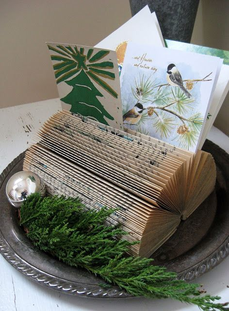 DIY Recycle...use a book with removed cover and folded pages on a tray to display your holiday cards