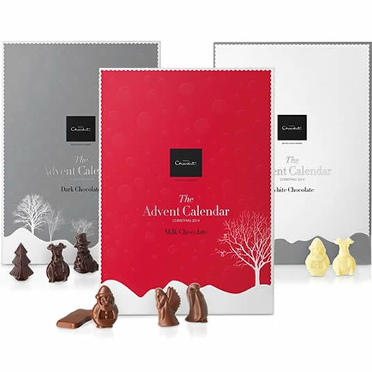 Chocolate filled advent calendars from Hotel Chocolat, a red advent calendar with 40% cocoa milk chocolate, white chocolate in the white calendar and 70% cocoa dark chocolate in the silver/grey...