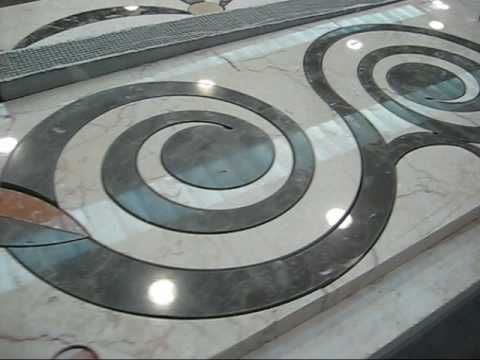 Water-jet cutting:  CNC nozzle sprays stream of water (sometimes with abrasives mixed in).  Can cut through foam, wood, metal, rubber, stone, and more - In thickness of 0-6+ inches. Standard for all Stone, glass, metal, and sign shops.  Cutting marble carpets using a water jet machine by Aquacut - YouTube