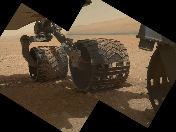 Mars Rover Curiosity: Wheel-Gazing Credit: NASA/JPL-Caltech/Malin Space Science SystemsThis view of the three left wheels of NASA's Mars rover Curiosity combines two images that were taken by the rover's Mars Hand Lens Imager (MAHLI) during the 34th Martian day, or sol, of Curiosity's work on Mars (Sept. 9, 2012). In the distance is the lower slope of Mount Sharp.