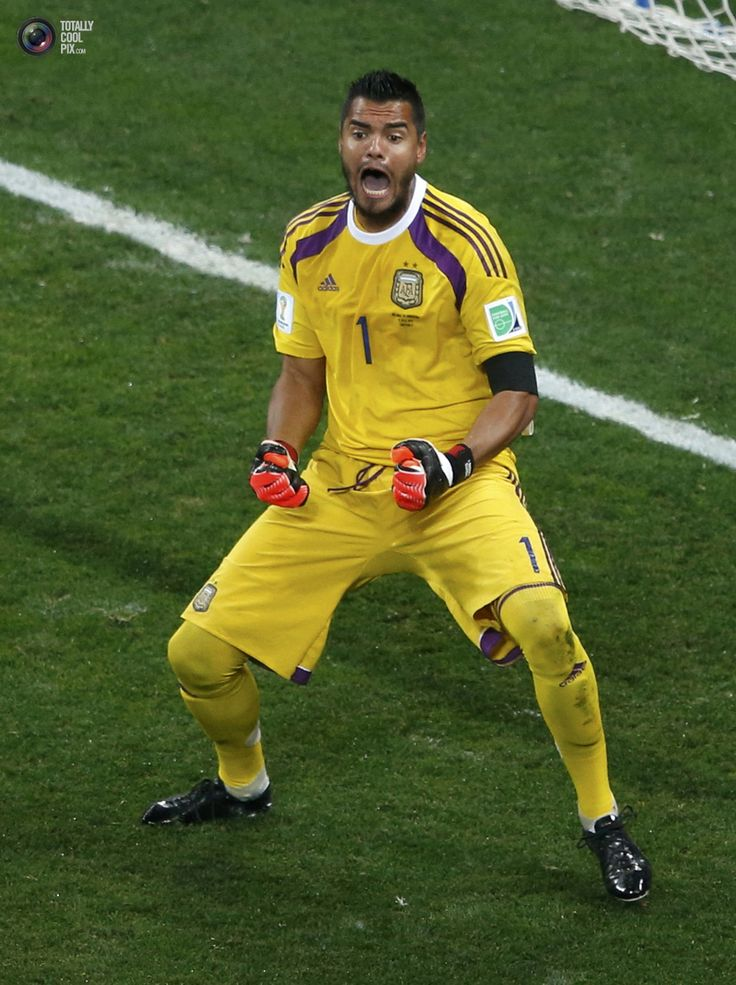 World Cup 2014: The Netherlands vs Argentina Semi-Final Highlights - Argentina's goalkeeper Sergio Romero reacts after saving a shot by Ron Vlaar of the Netherlands during a penalty shootout in their 2014 World Cup semi-finals at the Corinthians arena in Sao Paulo. PAULO WHITAKER/REUTERS