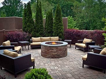 This modern courtyard shows the possibility courtyards have for use. A firepit is a great way to get people to gather and socialize.