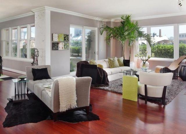 graue-waende-wohnzimmer-gruene-akzente-zimmerpflanze