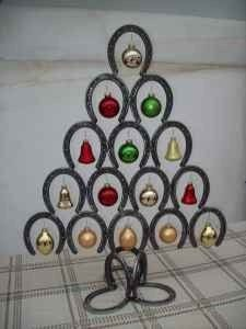 Horseshoe Christmas tree custom made!! The trees come with or without ornaments. These Christmas trees come in green or natural shoe color.