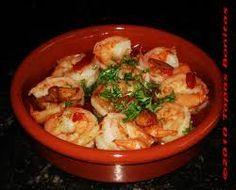 Garnalen in knoflook / * 12 grote garnalen (gepeld) * zout en peper * 2 eetl citroensap * 2 teentjes knoflook (geperst) * 2 eetl olijfolie * 2 eetl fijngehakte peterselie * cocktailprikkers -- Oven voorverwarmen op 220 graden. Meng de olijfolie met zout, peper, knoflook en citroensap. Meng de garnalen door de gekruide olie. Leg de garnalen in ovenvast schaaltje. Garnalen in plm. 10-15 minuten gaar laten worden. Voor serveren bestrooien met at gehakte peterselie. Prikker erin en smullen maar.
