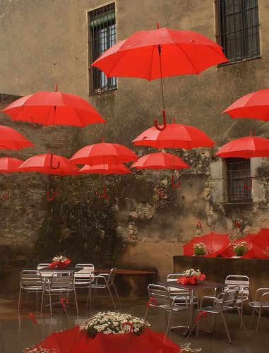 Umbrellas by Don_Gato (LoFi Photography), via Flickr.     I once planned on decorating my apartment this way! I was going to do the walls in a blue-gray and then hang red umbrellas all over the ceiling. So when I saw this I loved it immediately. Unfortunately, I don't know where it is.