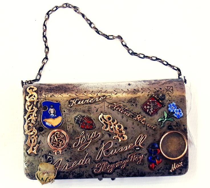 Russian engraved silver purse and chain, applied all over with gold coloured metal and enamel monograms, initials, facsimile names, German (?), motifs to include; skull, pistol, framed photograph with leather multi sectional interior, silver hallmarks and Cyrillic makers mark, possibly Moscow (indescribable) (af) 13cm wide Estimate £250.00 to £375.00 (Lot no: 139 in sale on 21/10/2014 - The Cotswold Auction Company)