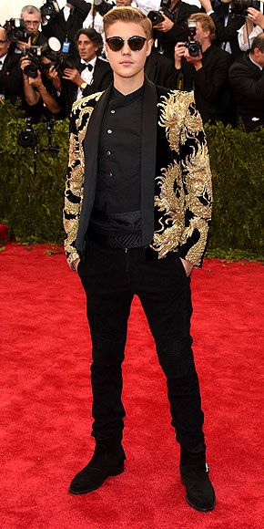 The Most Jaw-Dropping Dresses at the 2015 Met Gala | JUSTIN BIEBER | sporting his new haircut in a gold embroidered suit jacket, with black collarless shirt, black skinny pants and shades.