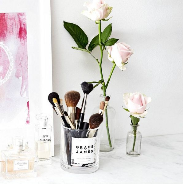 Makeup brushes look extra pretty when displayed in an empty candle container.  #refinery29 http://www.refinery29.com/makeup-organization-pictures#slide-14
