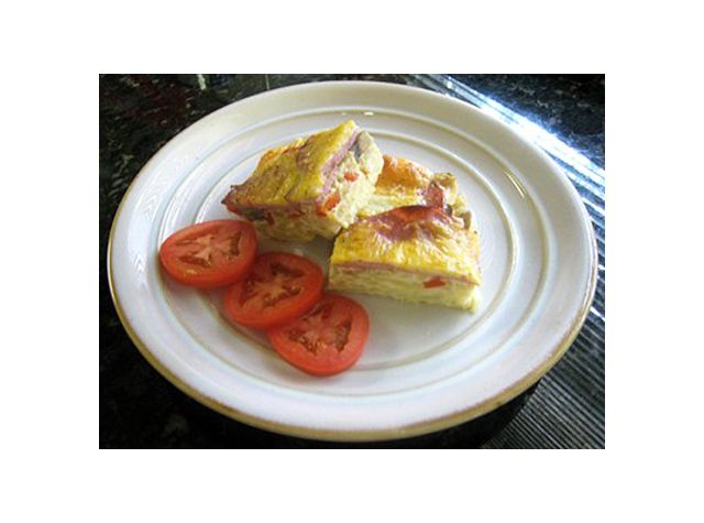 Breakfast lasagna is an egg casserole made with frozen hash browns, eggs, and bacon, from our forum. This is a nice breakfast casserole for a weekend family breakfast or holiday morning.