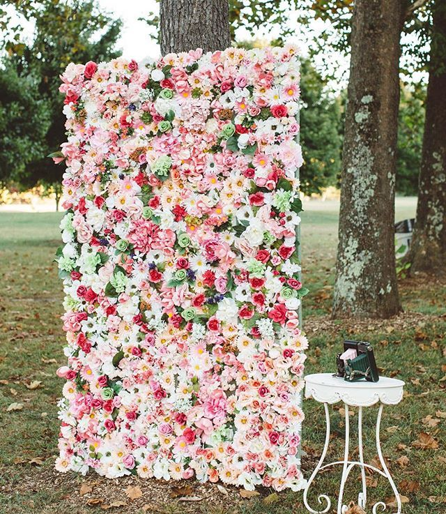 Wedding DIY idea: create a floral wall photo booth for a gorgeous, Insta-worthy session that your guests will love!  #BridesRealWeddings : @rachccouch | : @amoreeventco