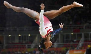 Simone Biles (USA) on the beam during the women's team final at the Rio Olympics.