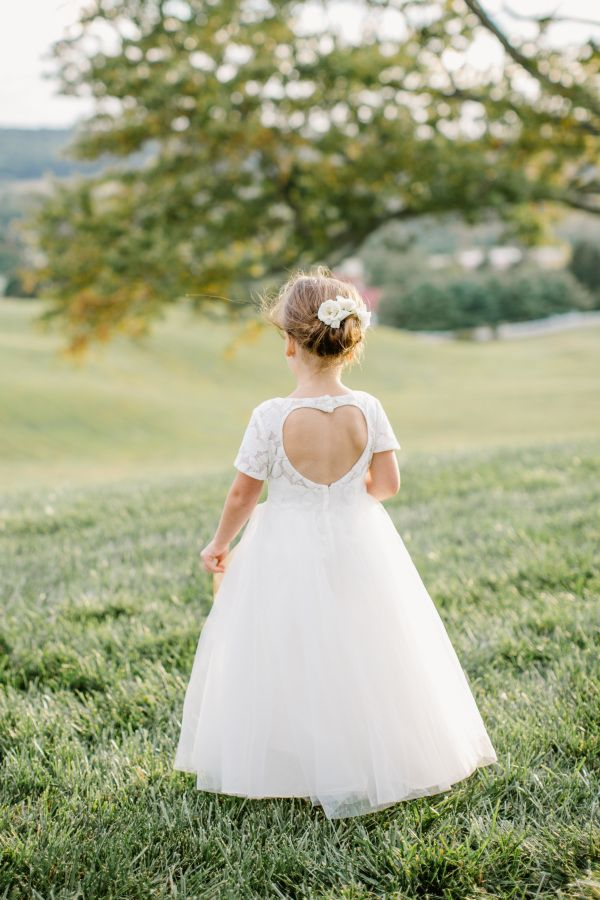 THE most adorable heart cut out flower girl dress: http://www.stylemepretty.com/maryland-weddings/baltimore/2016/03/24/classic-elegant-maryland-horse-farm-wedding/   Photography: Shannon Michele - http://shannonmichelephotography.com/