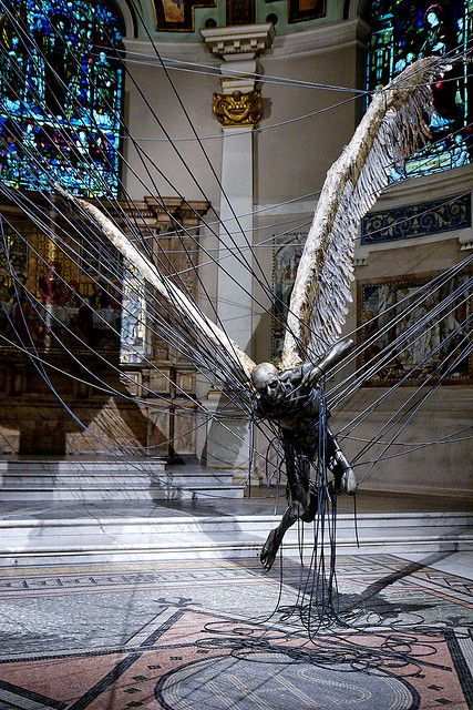 Paul Fryer (Morning Star), an installation at the Holy Church in Marylebone in 2008, which depicts a wax Lucifer suspended by high-power lines.