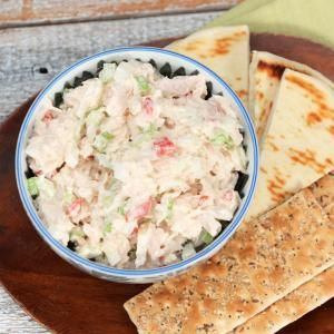 Pair this classic tuna salad with whole-grain crackers or warm pita wedges, or serve as a filling for wraps and pita pockets.