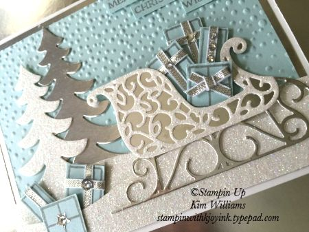 Stampin UP Santas Sleigh stamp set and framelits. World Card Making DAy BLOG HOP> www.stampinwithkjoyink.typepad.com. Kim Williams, Pink Pineapple Paper Crafts. I used lots of glimmer paper and silver foil for a spectacular Christmas card idea. All products from the STampin Up Holiday Catalog 2016-2017