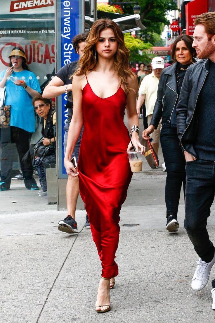 Selena Gomez wearing Nili Lotan Charmeuse Slip Gown and Saint Laurent Metallic Leather Jane Sandals