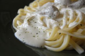 Olive Garden Fettuccine Alfredo Simmer 2-3 T of minced garlic (no powder) in the melting butter on medium for 1-2 minutes before adding the full 8 oz of cream cheese. It is so much better than OG and doesn't separate as bad when re-heated.