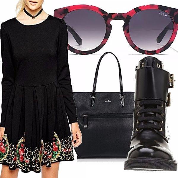 Outfit per chi andrà in vacanza al freddo...come me. L'abito è nero con decorazione ricamata sul fondo. La borsa e gli anfibi sono un must da avere nel guardaroba.