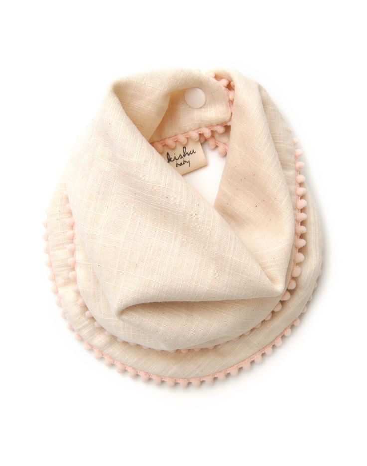Ivory Pom Pom Bib for Girls with Powder Pink Trim