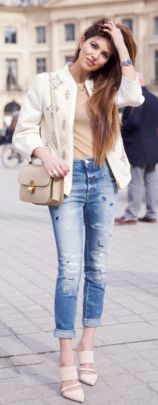 Negin Mirsalehi is wearing a beige embellished jacket from Ted Baker