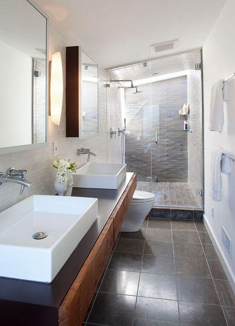 Dark tile bathroom floor, lighter color shower tile with darker accent tiles
