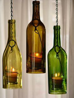 Repurposed wine bottle hanging candle lanterns
