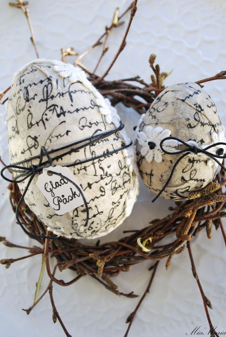 Decoupaged eggs with lovely script and a simple string tied. Love.