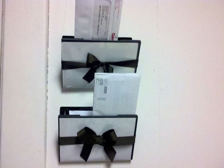 Everyone has a million dvd cases with some hot glue a ribbon and a screw I made mail holders. Tied the ribbon around to keep it from opening too far glued it in place and screwed it to the wall :)