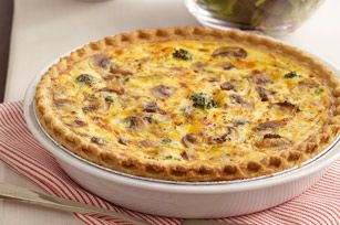 "Broccoli and Cheddar Quiche recipe - You'll love our easy-to-make ""cuppa"" quiche. It's a cup of broccoli, a cup of Cheddar and other good things—all baked into a frozen deep-dish pie crust. #brunch"