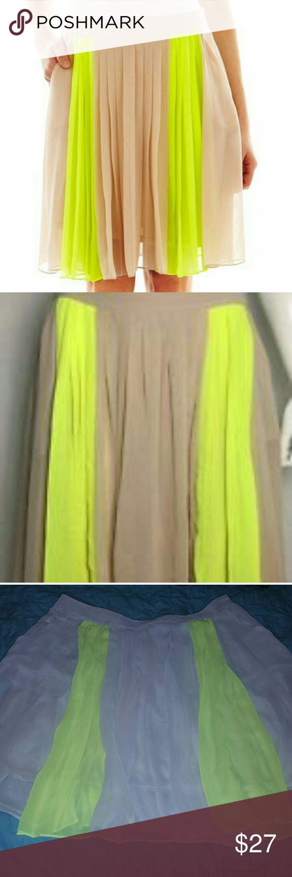 Worthington Pleated Neon Yellow Green/Cream Skirt Skirt Length: Close to Knee LengthFeatures: Pleated: KnitFabric Content: 100% PolyesterApparel Length: 22 : Machine Wash Cold with Pockets Flowy Style Sophisticated but Relaxing at the Sametime Worthington Skirts Circle & Skater