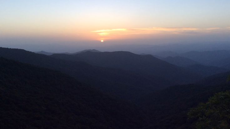 Watching the sun set on the Blue Ridge Mountains.