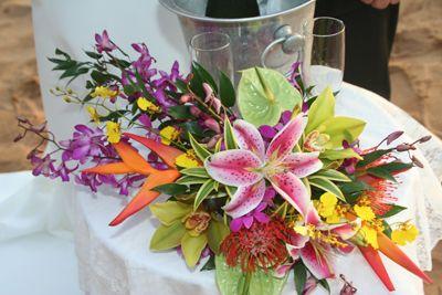Google Image Result for http://weddingflowersrainbow.com/wp-content/plugins/jobber-import-articles/photos/145144-hawaiian-wedding-flowers-2.jpg