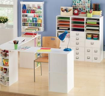 this is how I want my craft room (though not in themiddle, up against the wall under the window)