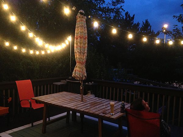How to hang string lights over a deck out back for How to hang string lights without trees