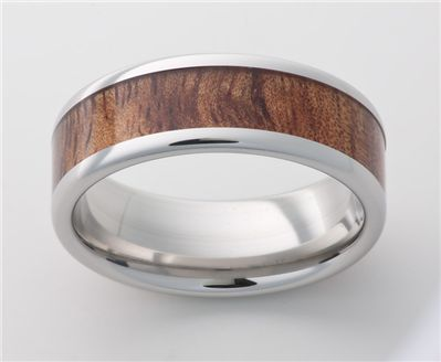 Vitalium Metal Band with an Exotic Hardwood In-Lay.  The Hardwood In-Lay is Tiger-Kao Wood.  Available at Martin Jewelry at Westroads Mall in Omaha, NE.  402-397-3771.  www.martinjewelry.net.