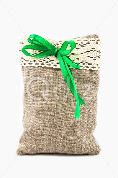 Qdiz Stock Photos | Decorative textile sachet pouch,  #background #bag #bow #burlap #cloth #container #craft #decoration #decorative #fabric #filled #gift #handmade #homemade #isolated #material #package #packaging #packet #poke #pouch #present #ribbon #sac #sachet #sack #small #sparse #textile #white