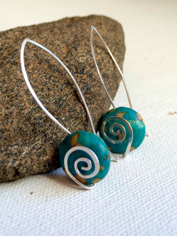 A personal favorite from my Etsy shop https://www.etsy.com/listing/279926320/silver-and-turquoise-earrings-with