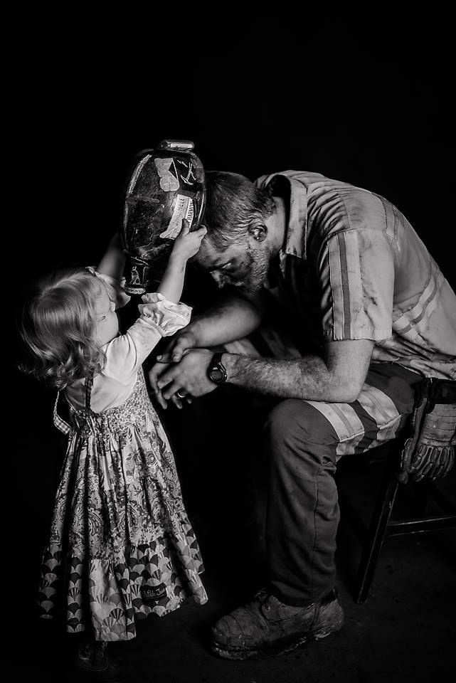 A coal miner and his daughter. This photo was taken by talented photographer Natalie Franklin.