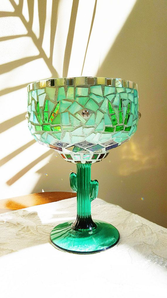 Saw this unique Margarita glass and just had to have it! I used beautiful transparent glass tiles in lovely shades, that just make you happy looking at it! I also used some genuine swarovski crystals as accents to give it a little extra sparkle. When this tea light is lit it shimmers all the colors around it. It looks fabulous at night. Great conversation piece to give as a gift to your favorite margarita lover, or keep it for yourself and enjoy