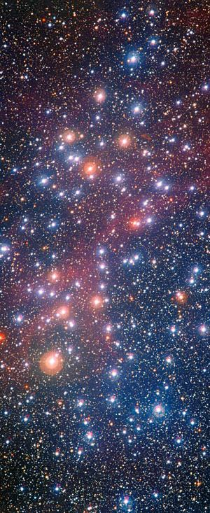 Located some 1300 light-years away in the constellation of Carina (The Keel of the ship Argo). It is informally known as the Wishing Well Cluster, as it resembles scattered silver coins which have been dropped into a well, It was the first target to be observed by the NASA/ESA Hubble Telescope. (May 1990) The stars that with moderate masses are still shining brightly with blue-white colors, but the more massive ones have already exhausted their supplies of hydrogen becoming red giant stars.