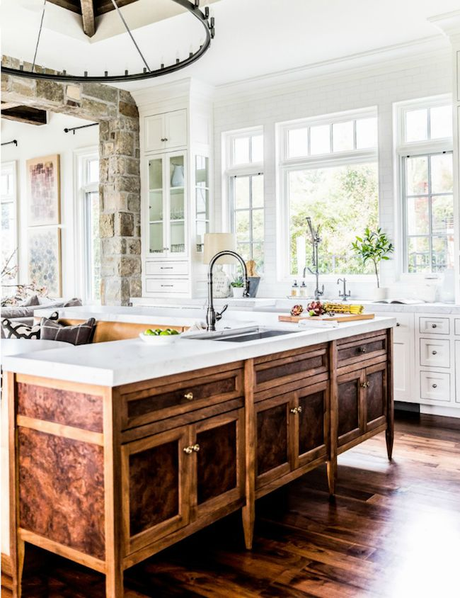The classic elegance in the faucets and sinks, combined with the intriguing contrast of the cabinets adds an attractive character to this kitchen! #kitchens #davejonesinc #madisonwi