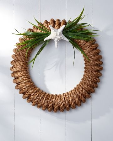 Decorate your door with this seaworthy take on a traditional holiday wreath. Made with woven rope and burlap, this durable ornament hangs handsomely on the exterior of any door. Embellishments resembling a starfish and sea grass provide the perfect finishing touch. Rope; burlap; EVA foam. 21in. in diam.. Made in USA. WH210014.