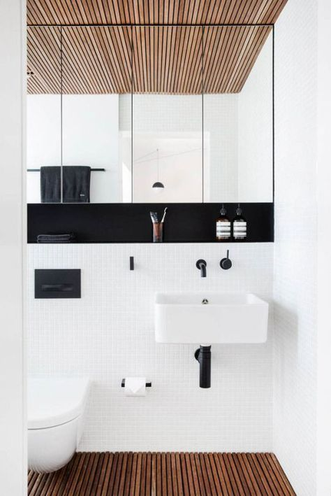 Wooden floor & celing in an otherwise monochrome bathroom