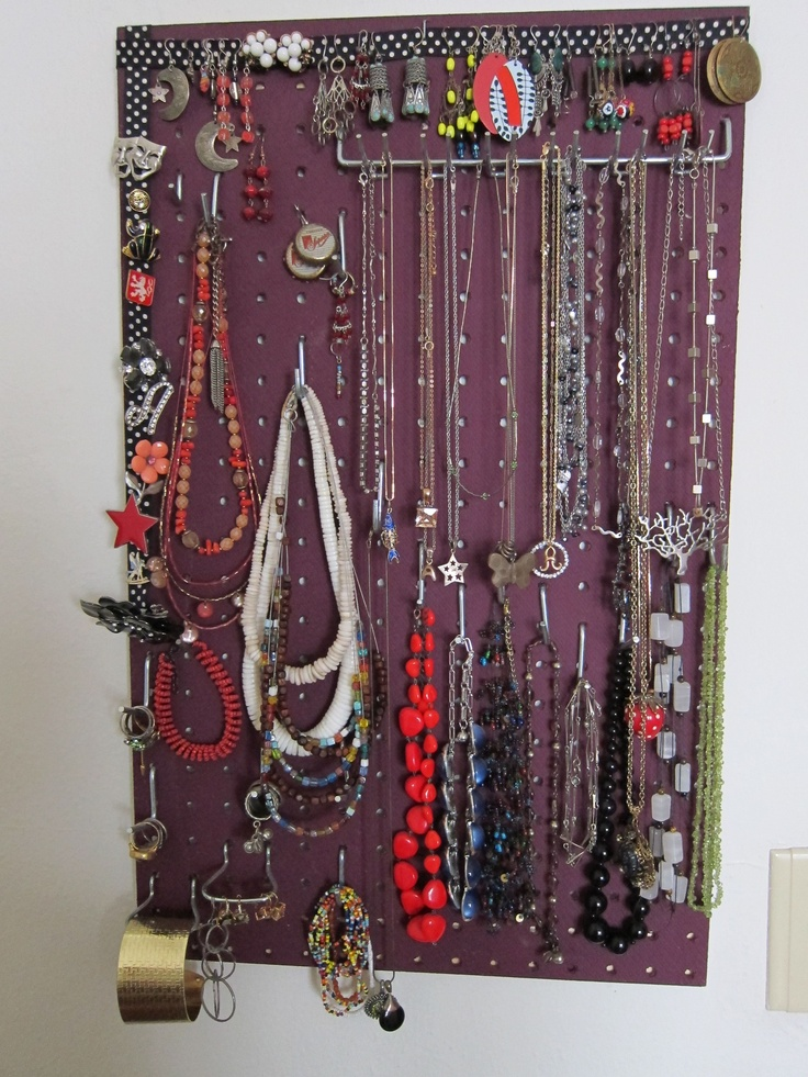 """Reader Annelise writes in about her jewelry storage solutions: """"I wanted to share one of my favorite projects--jewelry storage by pegboard. Make them cut it to whatever size you want at the hardware store, attach picture-hanging hardware, paint it and hang it up. I've added ribbon for pins and more dangly earrings, though you can just use the holes themselves, and you can get a huge assortment of hooks that seem like they're tailor-made for ridiculous bangles."""""""