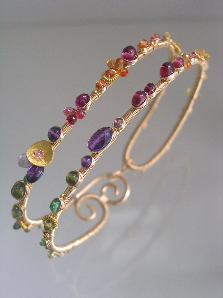 Wide Wire Wrapped Bracelet, Colorful Gemstone Bangle, Cosmopolitan Jewelry, Sapphire, Amethyst, Ruby, Tsavorite, Original Design, Signature by bellajewelsII on Etsy https://www.etsy.com/listing/196369593/wide-wire-wrapped-bracelet-colorful