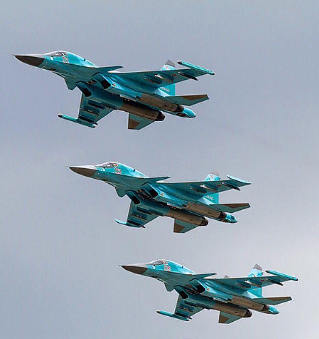 three Russian Air Force Sukhoi Su-34s make pass.