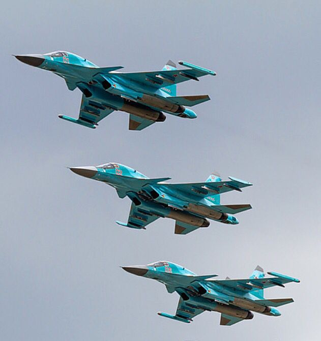three Russian Air Force Sukhoi Su-34s make pass.
